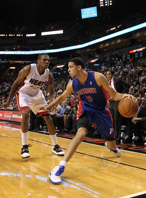 MIAMI, FL - DECEMBER 01:  Austin Daye #5 of the Detroit Pistons dribbles around  James Jones #22 of the Miami Heat during a game at American Airlines Arena on December 1, 2010 in Miami, Florida. NOTE TO USER: User expressly acknowledges and agrees that, b