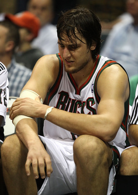 MILWAUKEE - NOVEMBER 16: Andrew Bogut #6 of the Milwaukee Bucks grabs his elbow as he sits on the bench near the end of a game against the Los Angeles Lakers at the Bradley Center on November 16, 2010 in Milwaukee, Wisconsin. The Lakers defeated the Bucks