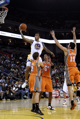 OAKLAND, CA - DECEMBER 02:  Monta Ellis #8 of the Golden State Warriors drives to the basket against the Phoenix Suns at Oracle Arena on December 2, 2010 in Oakland, California. NOTE TO USER: User expressly acknowledges and agrees that, by downloading and