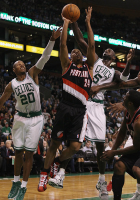 BOSTON - DECEMBER 01:  Andre Miller #24 of the Portland Trailblazers heads for the basket as Ray Allen #20 and Kevin Garnett #5 of the Boston Celtics defend on December 1, 2010 at the TD Garden in Boston, Massachusetts. The Celtics defeated the Trailblaze