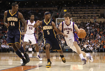 PHOENIX - DECEMBER 03:  Goran Dragic #2 of the Phoenix Suns drives with the ball against T.J. Ford #5 of the Indiana Pacers during the NBA game at US Airways Center on December 3, 2010 in Phoenix, Arizona.  The Suns defeated the Pacers 105-97.  NOTE TO US