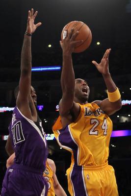LOS ANGELES, CA - DECEMBER 03:  Kobe Bryant #24 of the Los Angeles Lakers drives to the basket past Donte Greene #20 of the Sacramento Kings during the first half at Staples Center on December 3, 2010 in Los Angeles, California. The Lakers defeated the Ki