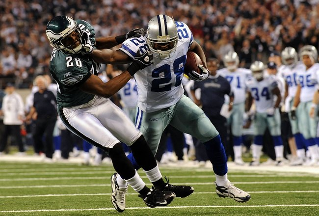 ARLINGTON, TX - JANUARY 09:  Running back Felix Jones #28 of the Dallas Cowboys runs the ball past Sean Jones #26 of the Philadelphia Eagles during the 2010 NFC wild-card playoff game at Cowboys Stadium on January 9, 2010 in Arlington, Texas.  (Photo by R