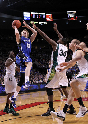 PORTLAND, OR - NOVEMBER 27:  Kyle Singler #12 of the Duke Blue Devils shoots  against the Oregon Ducks on November 27, 2010 at the Rose Garden in Portland, Oregon.  (Photo by Jonathan Ferrey/Getty Images)