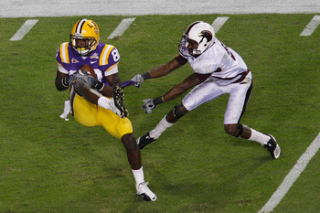 BATON ROUGE, LA - NOVEMBER 13:  Terrence Toliver #80 of the Louisiana State University Tigers makes a catch over Otis Peterson #9 of the University of Louisiana-Monroe Warhawks at Tiger Stadium on November 13, 2010 in Baton Rouge, Louisiana.   The Tigers