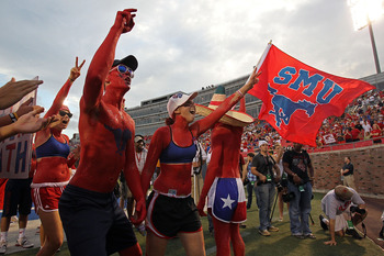 DALLAS - SEPTEMBER 24:  Fans of the SMU Mustangs wave a flag before a game against the TCU Horned Frogs at Gerald J. Ford Stadium on September 24, 2010 in Dallas, Texas.  (Photo by Ronald Martinez/Getty Images)