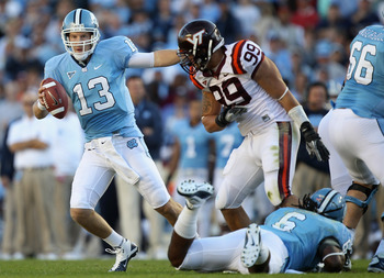 CHAPEL HILL, NC - NOVEMBER 13:  James Gayle #99 of the Virginia Tech Hokies runs after T.J. Yates #13 of the North Carolina Tar Heels during their game at Kenan Stadium on November 13, 2010 in Chapel Hill, North Carolina.  (Photo by Streeter Lecka/Getty I