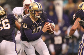 SEATTLE - OCTOBER 30:  Quarterback Jake Locker #10 of the Washington Huskies scrambles against the Stanford Cardinal on October 30, 2010 at Husky Stadium in Seattle, Washington. Stanford won 41-0. (Photo by Otto Greule Jr/Getty Images)
