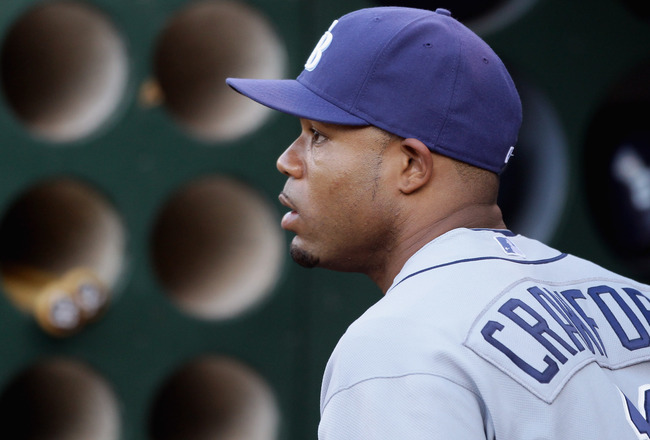 OAKLAND, CA - AUGUST 20:  Carl Crawford #13 of the Tampa Bay Rays stands in the dugout before their game against the Oakland Athletics at the Oakland-Alameda County Coliseum  on August 20, 2010 in Oakland, California.  (Photo by Ezra Shaw/Getty Images)