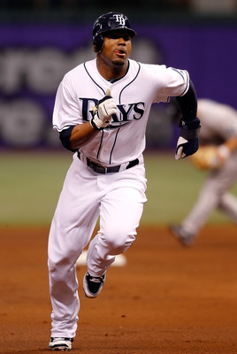 ST PETERSBURG, FL - APRIL 24:  Outfielder Carl Crawford #13 of the Tampa Bay Rays advances against the Toronto Blue Jays during the game at Tropicana Field on April 24, 2010 in St. Petersburg, Florida.  (Photo by J. Meric/Getty Images)