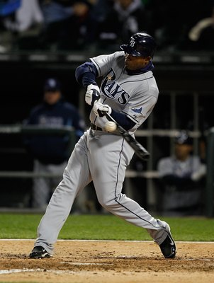 CHICAGO - APRIL 21: Carl Crawford #13 of the Tampa Bay Rays hits the ball against the Chicago White Sox at U.S. Cellular Field on April 21, 2010 in Chicago, Illinois. The Rays defeated the White Sox 12-0. (Photo by Jonathan Daniel/Getty Images)