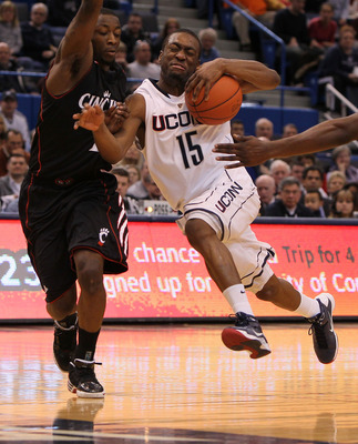 HARTFORD, CT - FEBRUARY 13: Kemba Walker #15 of the Connecticut Huskies drives toward the basket against the Cincinnati Bearcats at the XL Center on February 13, 2010 in Hartford, Connecticut. (Photo by Jim Rogash/Getty Images)