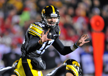 IOWA CITY, IA - NOVEMBER 20:  Quarterback Ricky Stanzi #12 of the University of Iowa Hawkeyes signals a call at the line during second half action against the Ohio State Buckeyes at Kinnick Stadium on November 20, 2010 in Iowa City, Iowa. Ohio State won 2