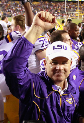 BATON ROUGE, LA - NOVEMBER 20:  Head coach Les Miles of the Louisiana State University Tigers celebrates after their 43-36 win over the Ole Miss Rebels at Tiger Stadium on November 20, 2010 in Baton Rouge, Louisiana.  (Photo by Kevin C. Cox/Getty Images)