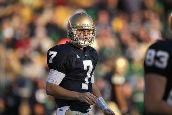 SOUTH BEND, IN - NOVEMBER 21:  Quarterback Jimmy Clausen #7 of the Notre Dame Fighting Irish looks downfield during the game against the Univeristy of Connecticut Huskies at Notre Dame Stadium on November 21, 2009 in South Bend, Indiana. (Photo by Jonatha