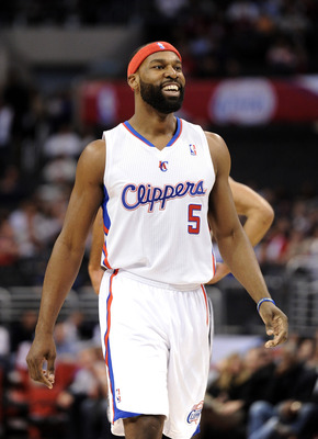 LOS ANGELES, CA - DECEMBER 01:  Baron Davis #5 of the Los Angeles Clippers celebrates his pass for a score against the the San Antonio Spurs at the Staples Center on December 1, 2010 in Los Angeles, California.  NOTE TO USER: User expressly acknowledges a