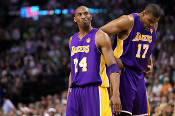BOSTON - JUNE 13:  (L-R) Kobe Bryant #24 and Andrew Bynum #17 of the Los Angeles Lakers look on against the Boston Celtics during Game Five of the 2010 NBA Finals on June 13, 2010 at TD Garden in Boston, Massachusetts. NOTE TO USER: User expressly acknowl