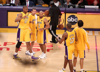 LOS ANGELES, CA - JUNE 03:  (L-R) Andrew Bynum #17, Jordan Farmar #1, Derek Fisher #2 and Ron Artest #37 of the Los Angeles Lakers celebrate after they won 102-89 against the Boston Celtics in Game One of the 2010 NBA Finals at Staples Center on June 3, 2