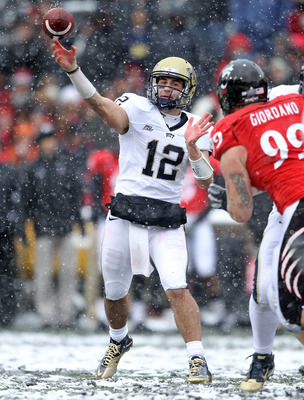 CINCINNATI, OH - DECEMBER 04: Tino Sunseri #12 of the Pittsburgh Panthers throws the ball during the Big East Conference game against the Cincinnati Bearcats at Nippert Stadium on December 4, 2010 in Cincinnati, Ohio.  Pittsburgh won 28-10.  (Photo by And