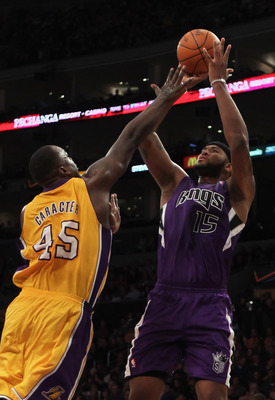LOS ANGELES, CA - DECEMBER 03:  DeMarcus Cousins #15 of the Sacramento Kings shoots over Derrick Caracter #45 of the Los Angeles Lakers during the second half at Staples Center on December 3, 2010 in Los Angeles, California. The Lakers defeated the Kings