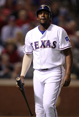 ARLINGTON, TX - OCTOBER 31:  Vladimir Guerrero #27 of the Texas Rangers reacts as he walks back to the dugout after he struck out in the fourth inning against the San Francisco Giants in Game Four of the 2010 MLB World Series at Rangers Ballpark in Arling