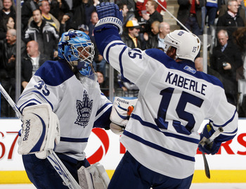 TORONTO, CANADA - DECEMBER 4: Jean-Sebastien Giguere #35 and Tomas Kaberle #15 of the Toronto Maple Leafs celebrate shoot-out win against the Boston Bruins during game action at the Air Canada Centre December 4, 2010 in Toronto, Ontario, Canada. (Photo by