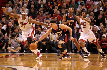 MIAMI, FL - DECEMBER 04: Mike Bibby #10 of the Atlanta Hawks fights for a loose ball against Eric Dampier #25 of the Miami Heat during a game at American Airlines Arena on December 4, 2010 in Miami, Florida. NOTE TO USER: User expressly acknowledges and a