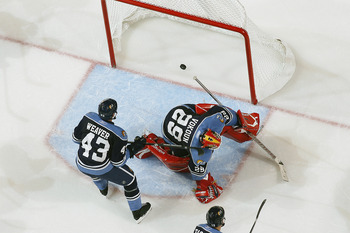 SUNRISE, FL - NOVEMBER 24: The goal scored by Mark Recchi #28 (not pictured) of the Boston Bruins goes into the net past goaltender Tomas Vokoun #29 of the Florida Panthers on November 24, 2010 at the BankAtlantic Center in Sunrise, Florida. The Bruins de