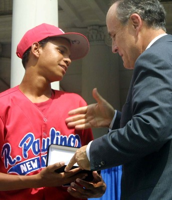 393788 03: Danny Almonte of the Rolando Paulino All-Stars Bronx Little League baseball team is presented with a key to the city by Mayor Rudolph Giuliani during a ceremony honoring the team August 28, 2001 in New York City. The team, which finished third