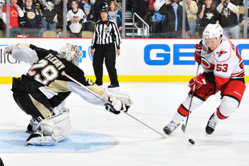 PITTSBURGH - NOVEMBER 19:  Goaltender Marc-Andre Fleury #29 of the Pittsburgh Penguins attempts a poke check on Jeff Skinner #53 of the Carolina Hurricanes during the shootout on November 19, 2010 at Consol Energy Center in Pittsburgh, Pennsylvania. Pitts