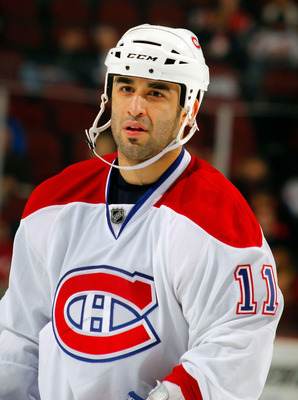 NEWARK, NJ - DECEMBER 02:  Scott Gomez #11 of the Montreal Canadiens during a hockey game against the New Jersey Devils at the Prudential Center on December 2, 2010 in Newark, New Jersey. The Canadiens won 5-1. (Photo by Paul Bereswill/Getty Images)