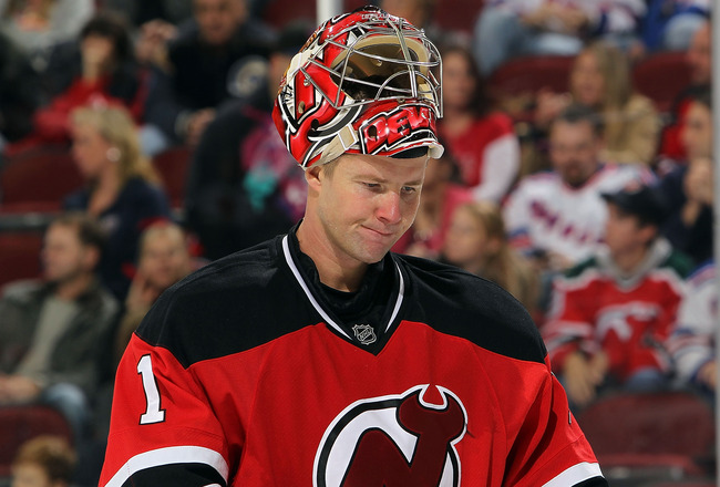 NEWARK, NJ - NOVEMBER 05: Johan Hedberg #1 of the New Jersey Devils reacts after the 3-0 loss to the New York Rangers at the Prudential Center on November 5, 2010 in Newark, New Jersey.  (Photo by Nick Laham/Getty Images)