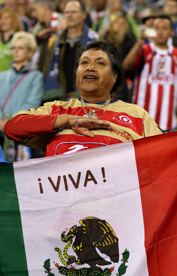 SEATTLE - OCTOBER 12:  A fan of Chivas de Guadalajara stands at attention during the national anthem prior to the game against the Seattle Sounders FC on October 12, 2010 at Qwest Field in Seattle, Washington. The Sounders defeated Chivas de Guadalajara 3