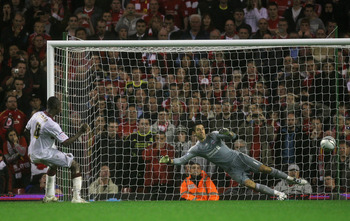 LIVERPOOL, ENGLAND - SEPTEMBER 22:  Abdul Osman of Northampton Town scores the winning penalty in a shootout past Brad Jones of Liverpool during the Carling Cup Third Round game between Liverpool and Northampton Town at Anfield on September 22, 2010 in Li