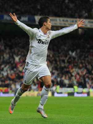 MADRID, SPAIN - DECEMBER 04:  Cristiano Ronaldo of Real Madrid celebrates scoring his sides opening goal during the La Liga match between Real Madrid and Valencia at Estadio Santiago Bernabeu on December 4, 2010 in Madrid, Spain.  (Photo by Jasper Juinen/