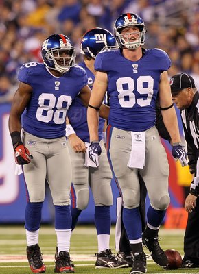 EAST RUTHERFORD, NJ - NOVEMBER 14:  Kevin Boss #89 and Hakeem Nicks #88 of the New York Giants look on against the Dallas Cowboys on November 14, 2010 at the New Meadowlands Stadium in East Rutherford, New Jersey. The Cowboys defeated the Giants 33-20.  (