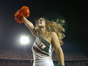 MIAMI, FL - SEPTEMBER 20: A  cheerleader from the University of Miami Hurricanes entertains during play against Texas A&M Aggies at the Orange Bowl on September 20, 2007 in Miami, Florida.  Miami won 31-17.  (Photo by Al Messerschmidt/Getty Images) *** Lo