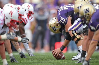 SEATTLE - SEPTEMBER 18: Center Drew Schaefer #73 of the Washington Huskies prepares to snap the ball against the Nebraska Cornhuskers on September 18, 2010 at Husky Stadium in Seattle, Washington. (Photo by Otto Greule Jr/Getty Images)