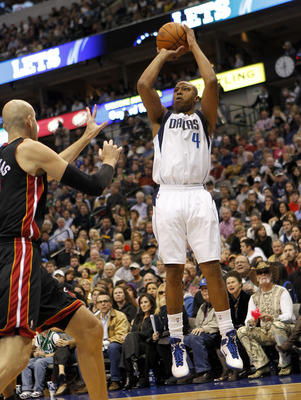 DALLAS - NOVEMBER 27: Caron Butler #4 of the Dallas Mavericks shoots over Zydrunas IIgauskas #11 of the Miami Heat on November 27, 2010 at the American Airlines Center in Dallas, Texas. NOTE TO USER: User expressly acknowledges and agrees that, by downloa