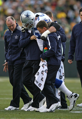 GREEN BAY, WI - NOVEMBER 15: Marc Colombo #75 of the Dallas Cowboys is helped off the field after an injury against the Green Bay Packers at Lambeau Field on November 15, 2009 in Green Bay, Wisconsin. (Photo by Jonathan Daniel/Getty Images)