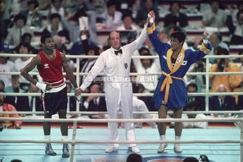 Jones-and-the-eventual-winner-of-the-1988-olympic-lt-middleweight-boxing-title-park-si-hun-whose-hand-is-raised-by-italian-referee-aldo-leoni_display_image
