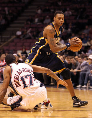 EAST RUTHERFORD, NJ - NOVEMBER 17:  Brandon Rush #25 of the New Jersey Nets dribbles past Chris Douglas Roberts #17 of The Indiana Pacers during their game on November 17, 2009 at The Izod Center in East Rutherford, New Jersey.  NOTE TO USER: User express