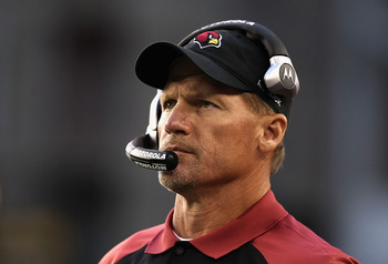 GLENDALE, AZ - DECEMBER 05:  Head coach Ken Whisenhunt of the Arizona Cardinals watches from the sidelines during the NFL game against the St. Louis Rams at the University of Phoenix Stadium on December 5, 2010 in Glendale, Arizona. The Rams defeated the 
