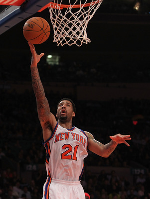 NEW YORK, NY - NOVEMBER 30:  Wilson Chandler #21 of the New York Knicks lays the ball up against the New Jersey Nets on November 30, 2010 at Madison Square Garden in New York City. NOTE TO USER: User expressly acknowledges and agrees that, by downloading