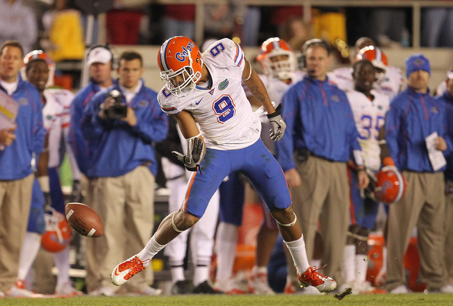 TALLAHASSEE, FL - NOVEMBER 27:  Carl Moore #9 of the Florida Gators miises a catch during a game against the Florida State Seminoles at Doak Campbell Stadium on November 27, 2010 in Tallahassee, Florida.  (Photo by Mike Ehrmann/Getty Images)