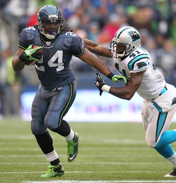SEATTLE - DECEMBER 05:  Running back Marshawn Lynch #24 of the Seattle Seahawks rushes against Captain Munnerlyn #41 of the Carolina Panthers at Qwest Field on December 5, 2010 in Seattle, Washington. The Seahawks defeated the Panthers 31-14. (Photo by Ot