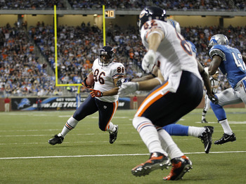 DETROIT - DECEMBER 05:  Brandon Manumaleuna #86 of the Chicago Bears runs for a fourth quarter touchdown as Greg Olsen #82 blocks during the game against the Detroit Lions at Ford Field on December 5, 2010 in Detroit, Michigan. The Bears defeated the Lion