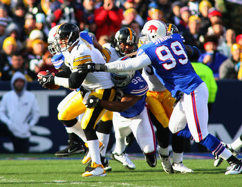 ORCHARD PARK, NY - NOVEMBER 28:  Ben Roethlisberger #7 of the Pittsburgh Steelers is sacked by Alez Carrington #92 and Marcus Stroud #99 of  the Buffalo Bills at Ralph Wilson Stadium at Ralph Wilson Stadium on November 28, 2010 in Orchard Park, New York.