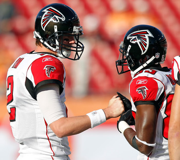 TAMPA, FL - DECEMBER 05:  Quarterback Matt Ryan #2 and receiver Harry Douglas #83 of the Atlanta Falcons talk just before the start of the game against the Tampa Bay Buccaneers at Raymond James Stadium on December 5, 2010 in Tampa, Florida.  (Photo by J.