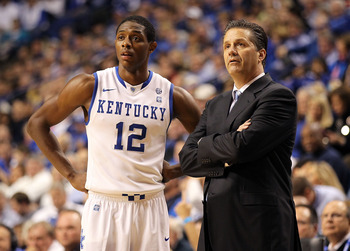 LEXINGTON, KY - NOVEMBER 30:  Brandon Knight #12 of the Kentucky Wildcats watches the game with Head Coach John Calipari during the game against the Boston University Terriers on November 30, 2010 in Lexington, Kentucky.  (Photo by Andy Lyons/Getty Images